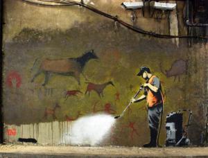 Bansky Painting. Man washing cave painting.